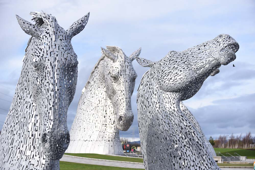 Two Kelpies have just become four ! The 2 original Kelpies have now been joined by 2 new friends, the maquettes that have travelled the world to share the unique story of the Kelpies , the Kelpies were born out of a regeneration project for some disused land between Falkirk and Grangemouth , Nowadays they are the jewel in the crown of the Helix Park with over 2 million visitors in five years , The Kelpies are a tribute to the Clydesdale horses that used to pull barges along the canals in Scotland in the 19th century. Each one is a hundred feet high and constructed from 300 tonnes of steel . A metal framework provided the basis for each horse and hundreds of plates , each one a unique design , were then welded onto the structure .